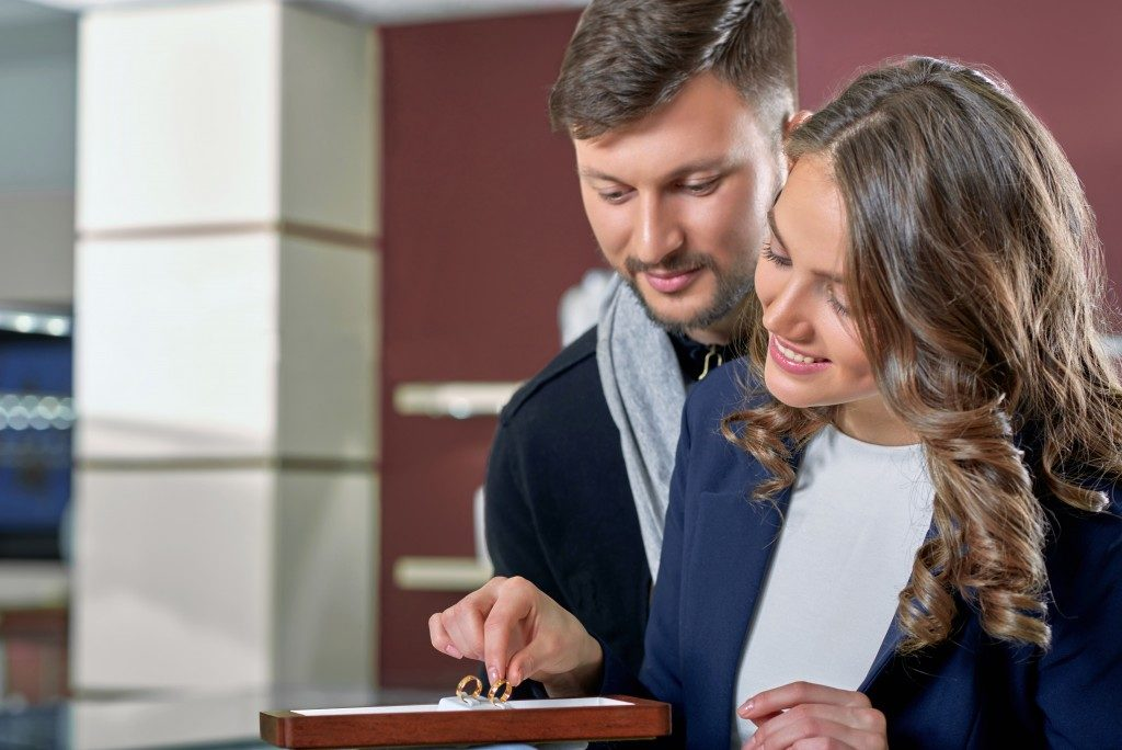 Couple buying an engagement ring
