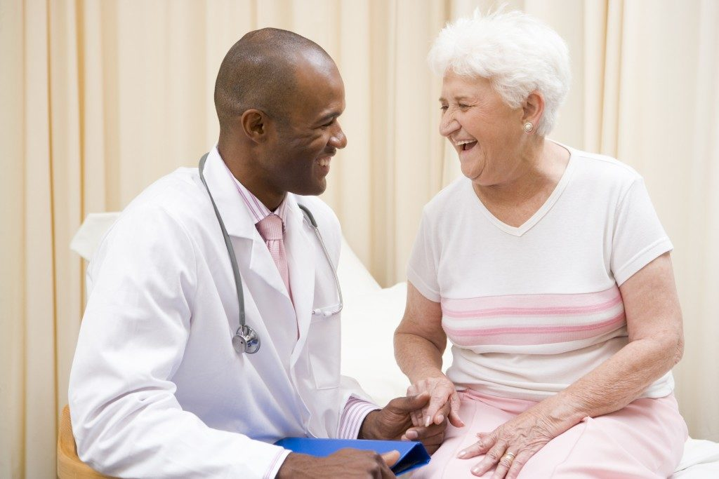 Doctor and patient smiling at each other