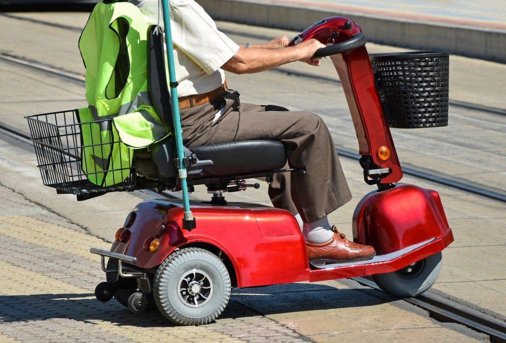 Elderly in an electric wheelchair