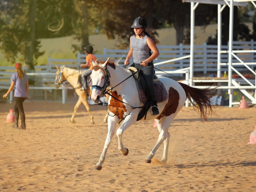 woman horseback riding