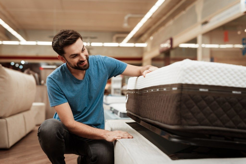 man choosing mattress