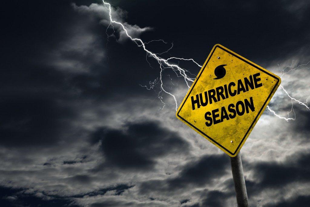hurricane season sign with thunderstorm