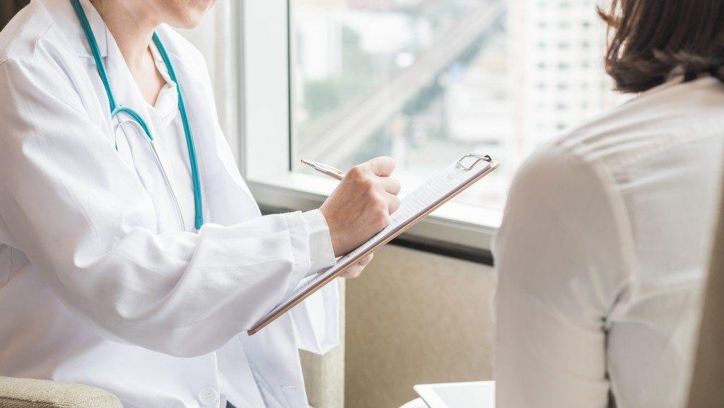 doctor prescribing patient