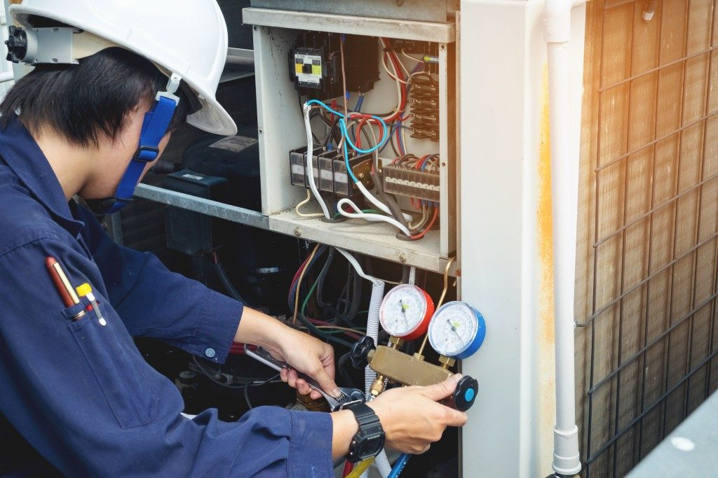 HVAC technician checking the unit