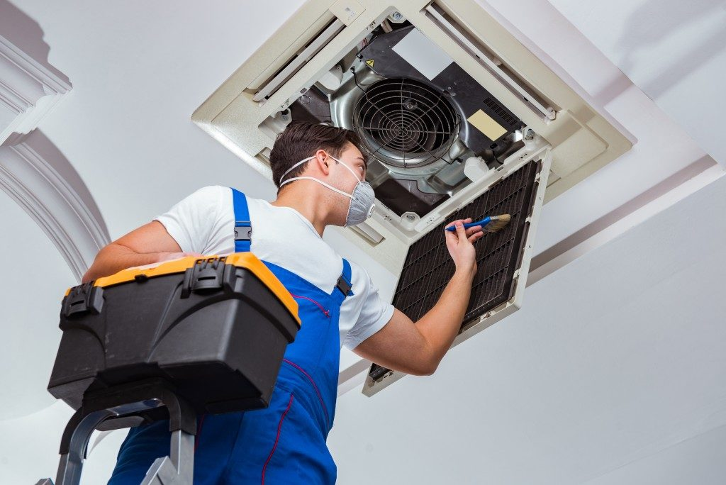 professional cleaner cleaning an hvac