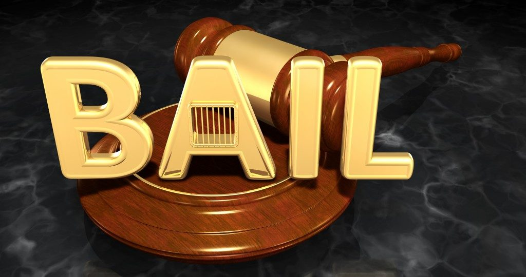 bail letters beside a gavel