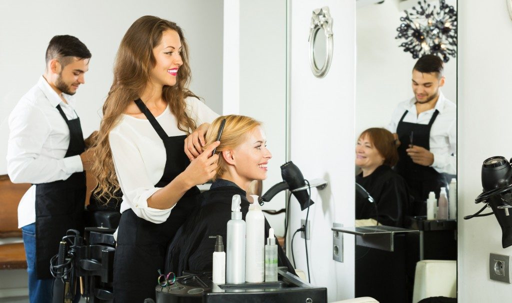 woman getting her hair done at the salon