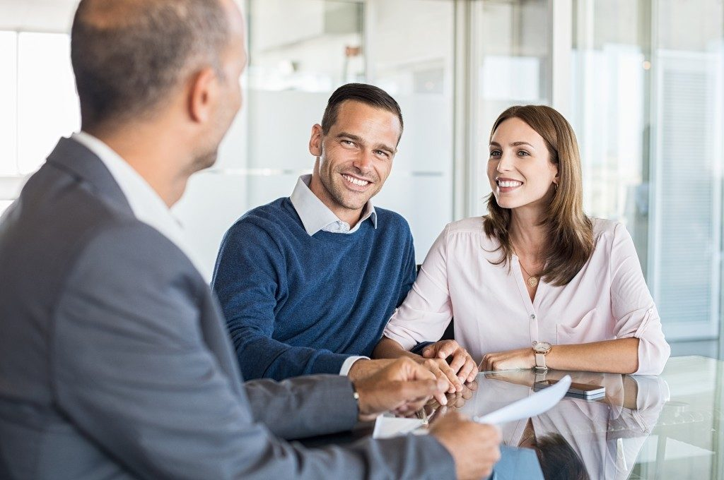 Couple consulting a businessman