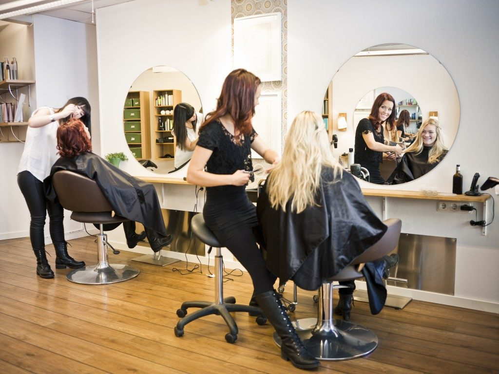 women getting their hair done at the salon