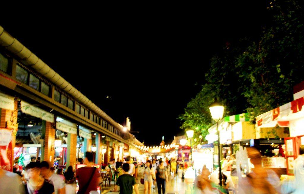blurred moving shopper at night bazaar market