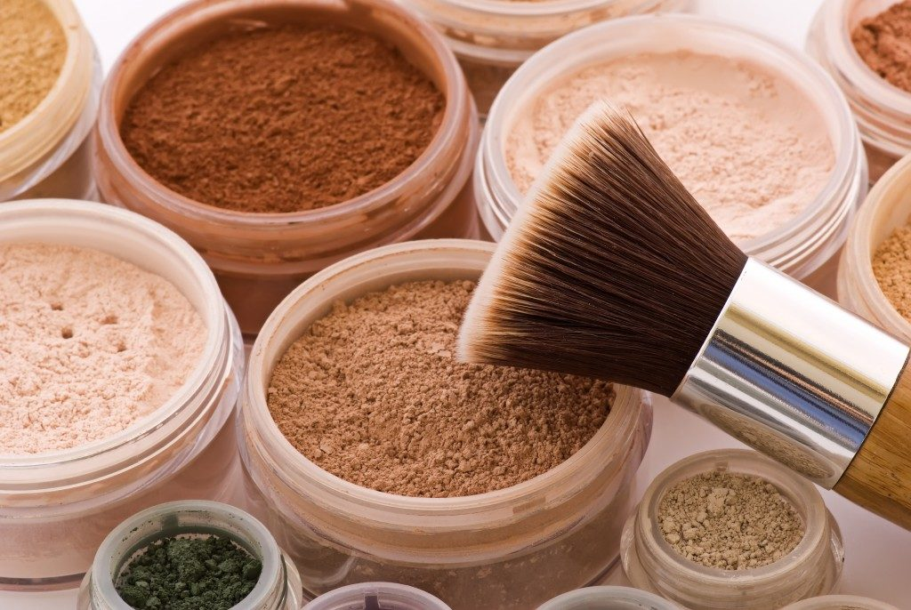 powdered make up and make up brush