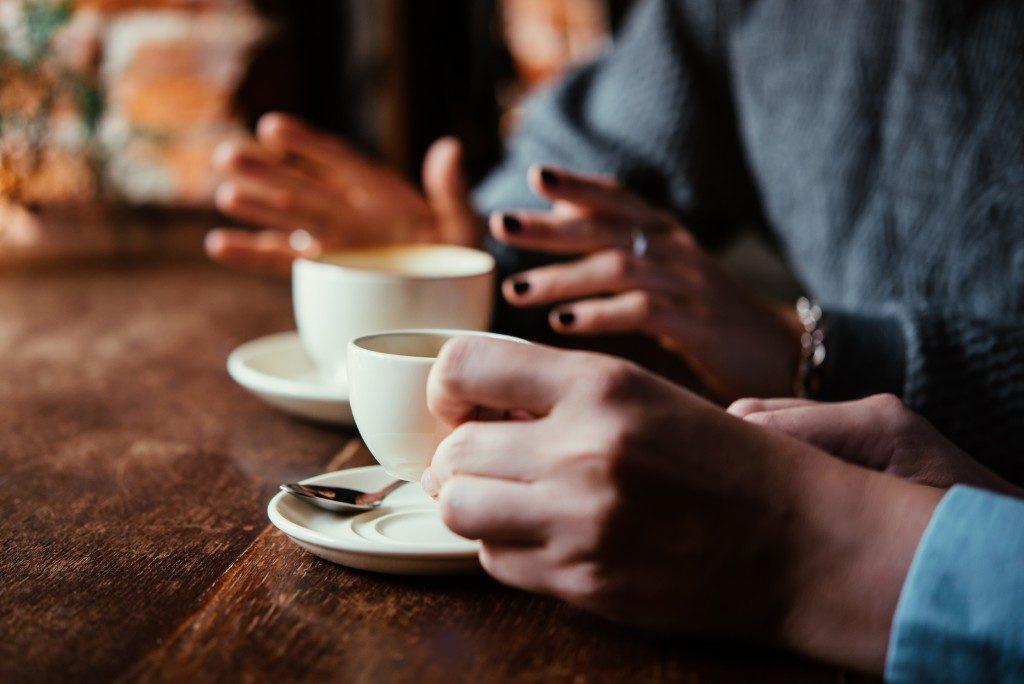 Having conversation over coffee