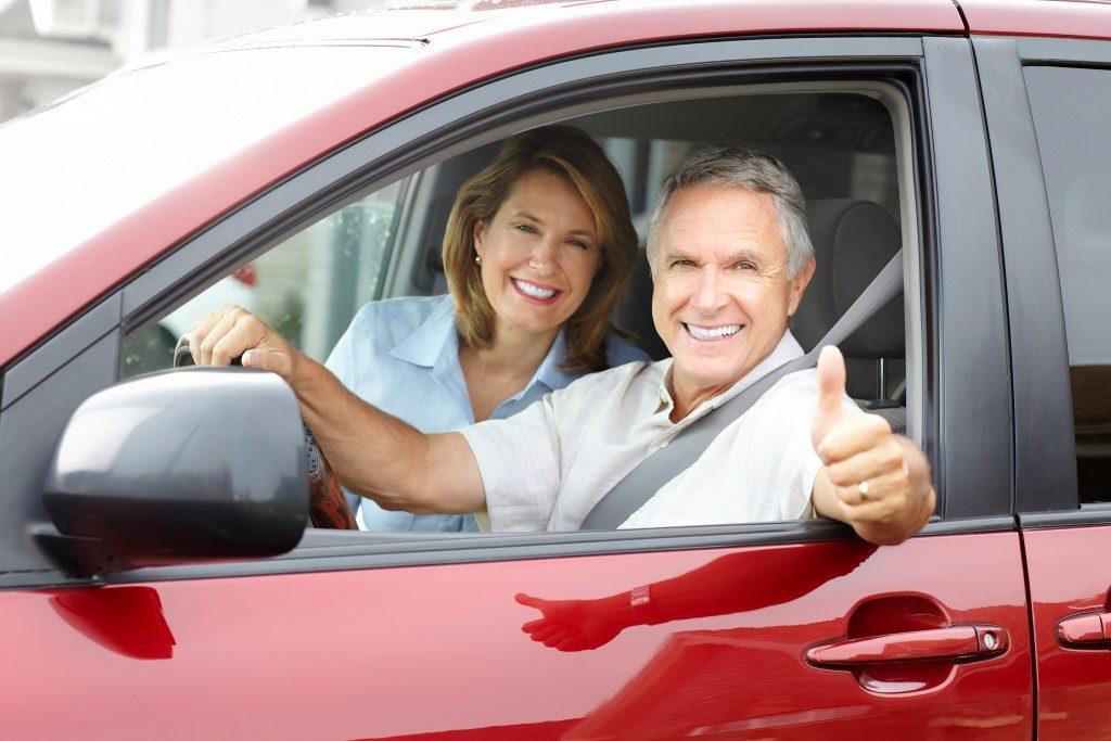 Elderly couple inside a car