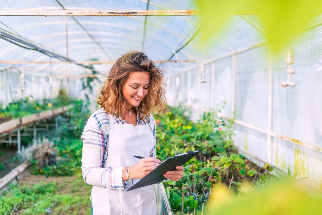 Woman in a greenhouse