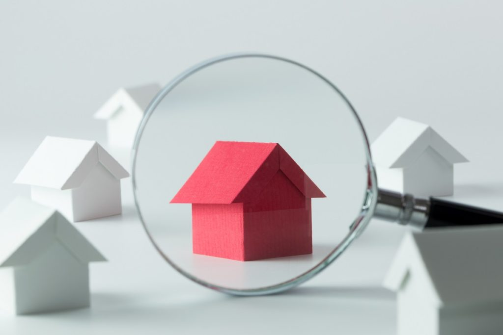 magnifying glass over home figures