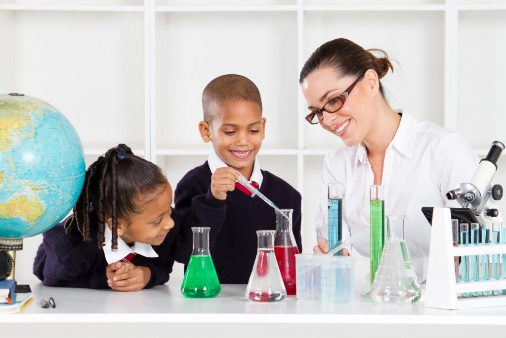 Woman teaching science to children