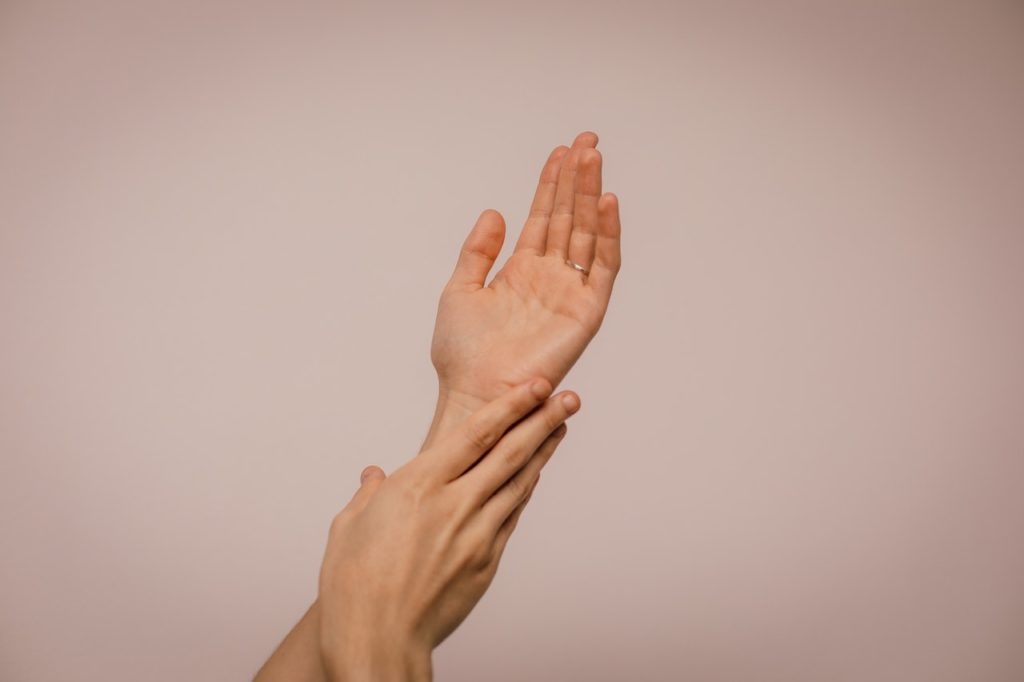 massaging own hands
