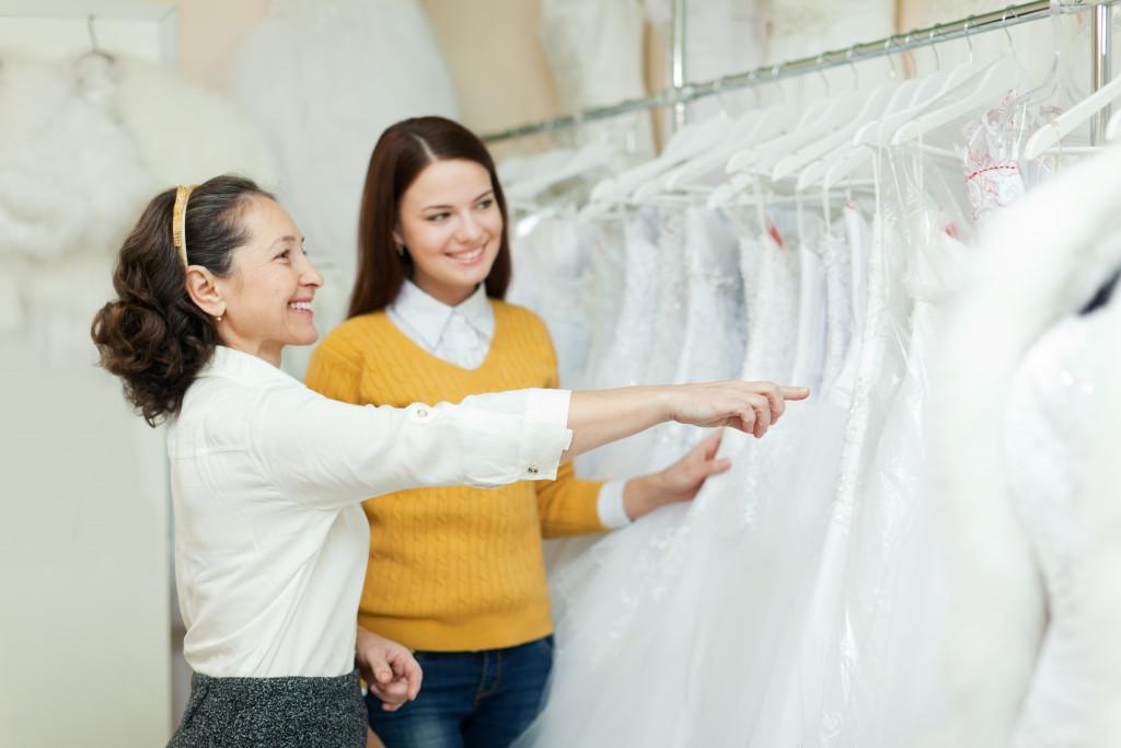 woman picking a wedding dress