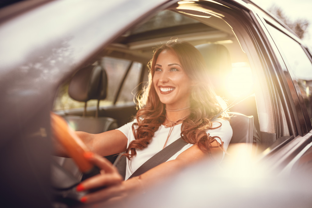 woman driving a car while smiling